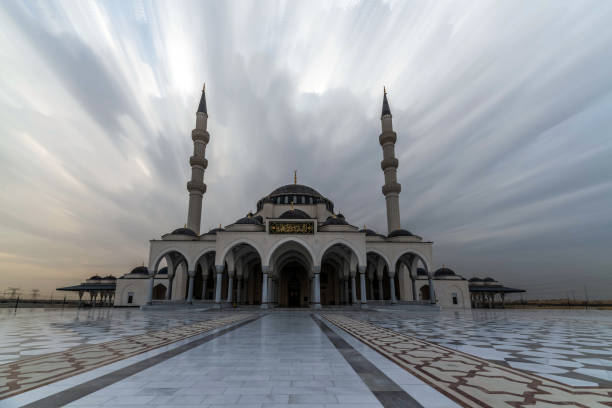 Turkish Style Sharjah Mosque under Cloudy Sky in Sharjah, United Arab Emirates