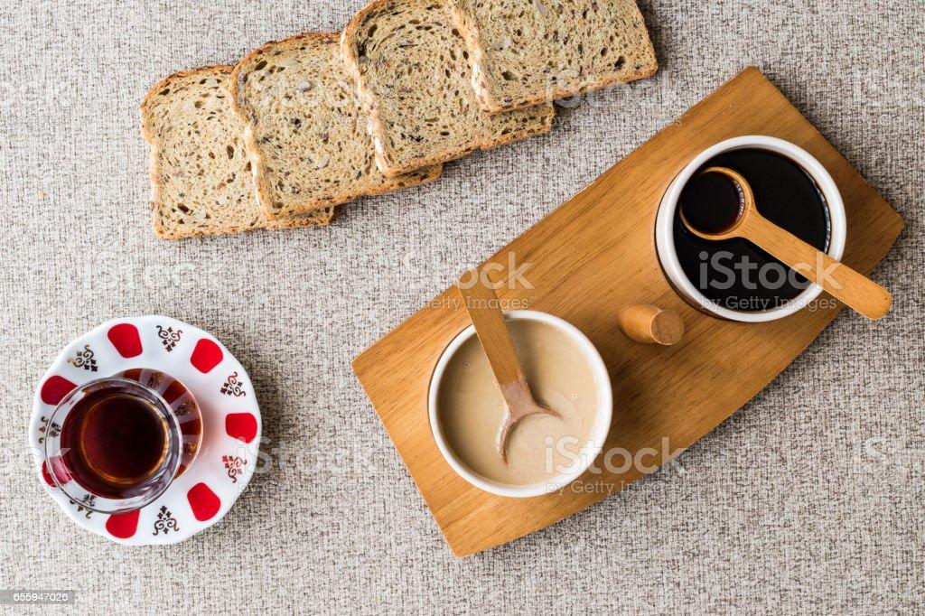 Turkish Tahin Pekmez / Tahini and Molasses with tea. stock photo