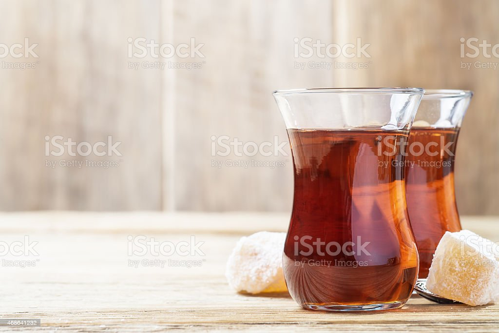 Turkish tea and oriental sweets. Space for text stock photo