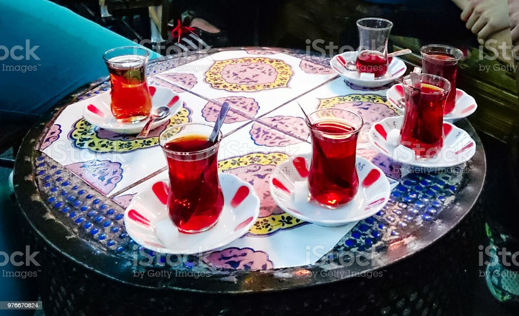 Turkish tea in a restaurant in traditional glass on a table with a...