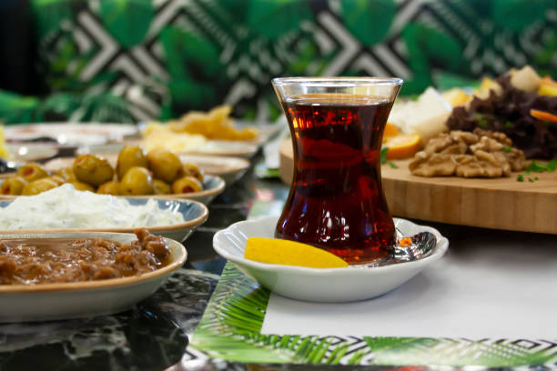 Turkish tea in traditional glass on wooden plate closeup stock photo
