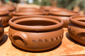 Turkish traditional earthenware pot. turkish pot made of clay is a Guvec. Selective focus.