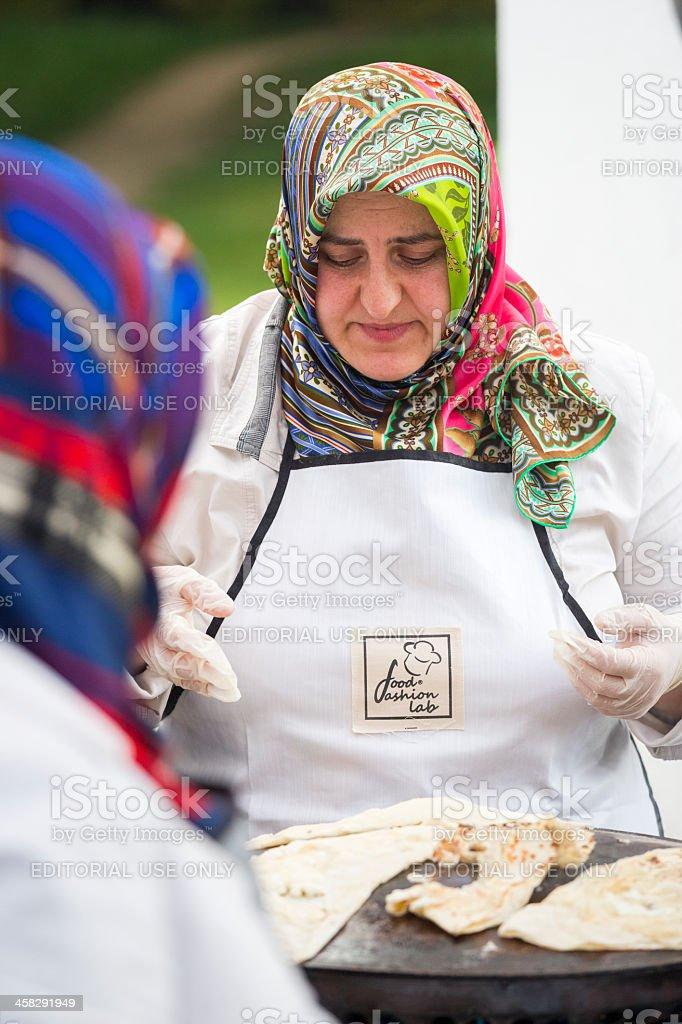 Turkish woman baking pies royalty-free stock photo
