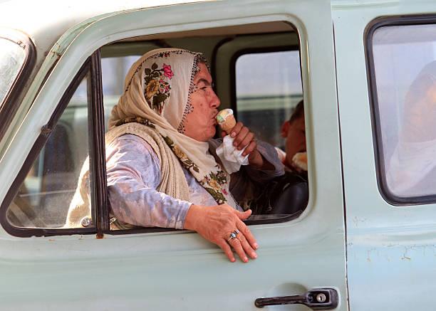 Turkish woman eating ice cream stock photo