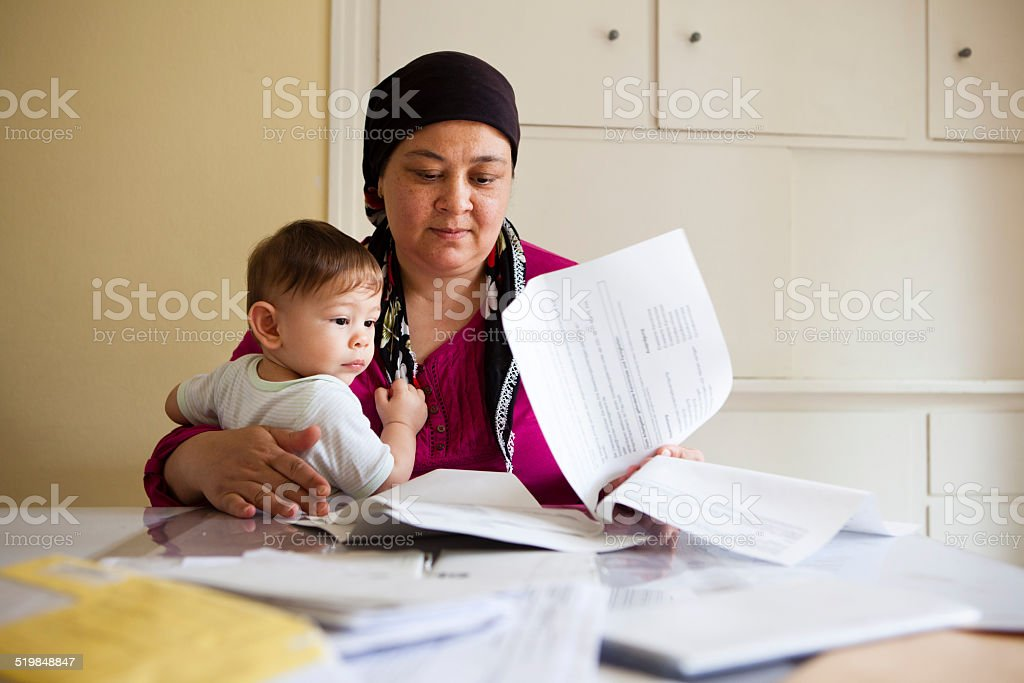 turkish woman looks helpless through the paperwork stock photo