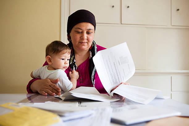 turkish woman looks helpless through the paperwork stock photo