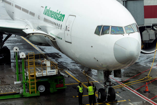 A Turkmenistan Airlines Boeing 777-200LR is waiting for its passengers at Ataturk Istanbul Airport, Turkey, at 28th of November, 2018, while being serviced by Havas Ground Services. stock photo