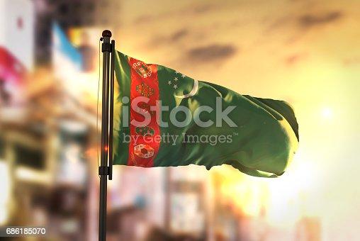 istock Turkmenistan Flag Against City Blurred Background At Sunrise Backlight 686185070