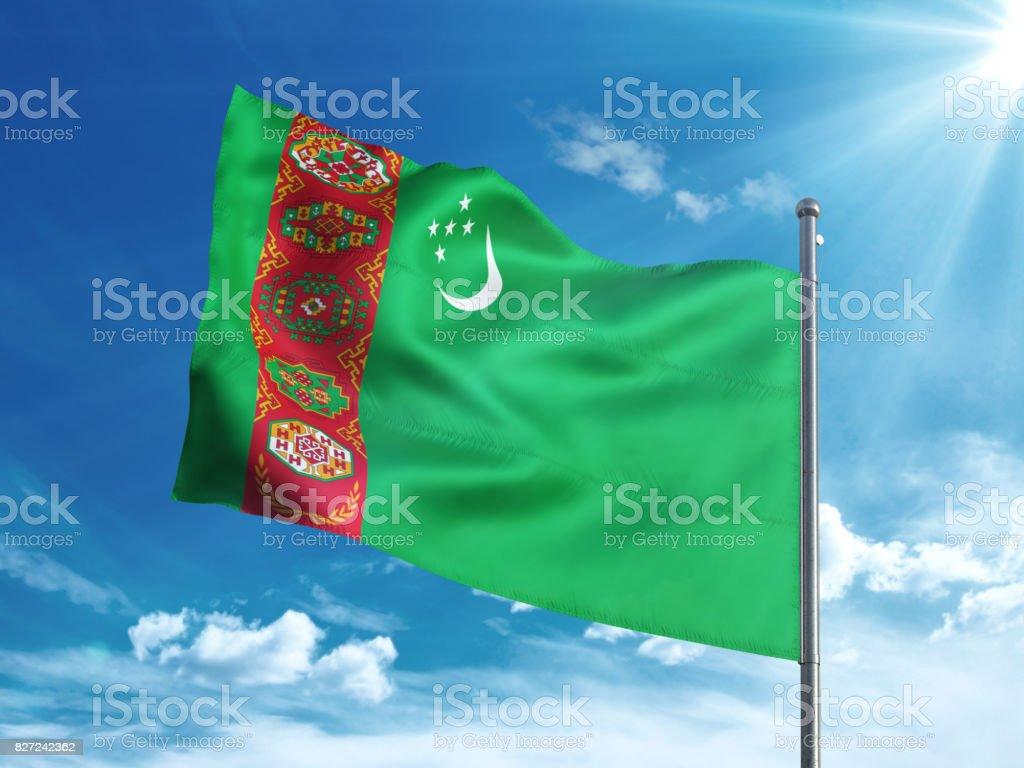 Turkmenistan flag waving in the blue sky stock photo