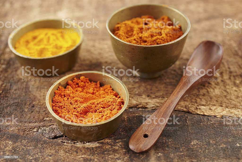 Turmeric and sandalwood powder on a distressed wood surface stock photo
