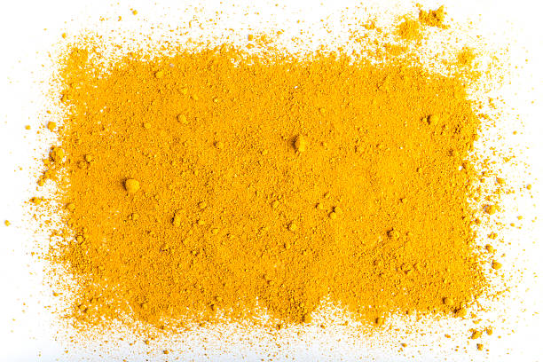 Turmeric background isolated on white Turmeric powder background isolated on white, rectangular shape. This element can bee used as a design background related to spice usage. curry powder stock pictures, royalty-free photos & images