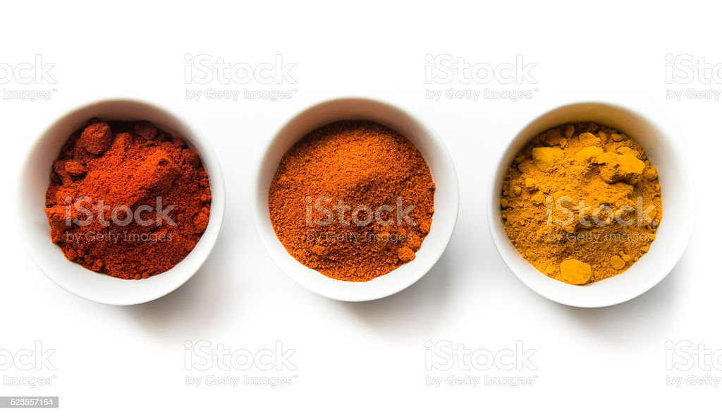 Turmeric, Cayenne, and Paprika in Bowls in a Row stock photo