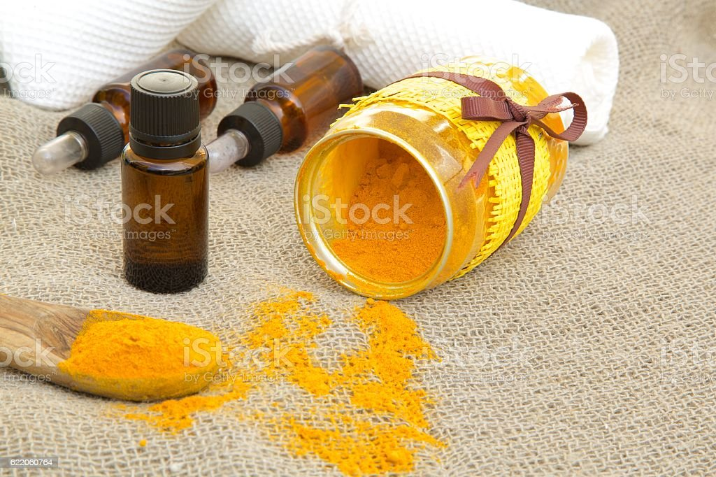 Turmeric essential oil stock photo