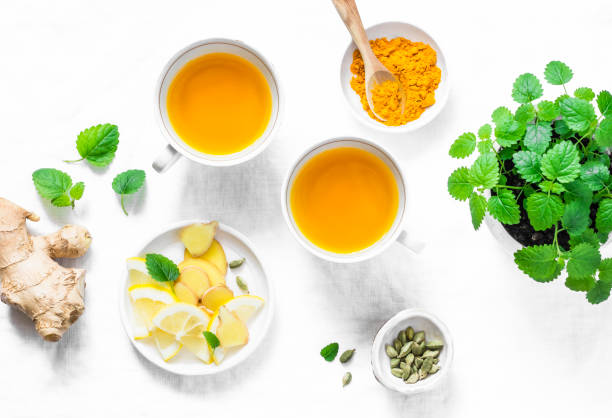 turmeric, ginger anti-inflammatory green tea.  healthy detox drink on light background, top view - infiammazione foto e immagini stock