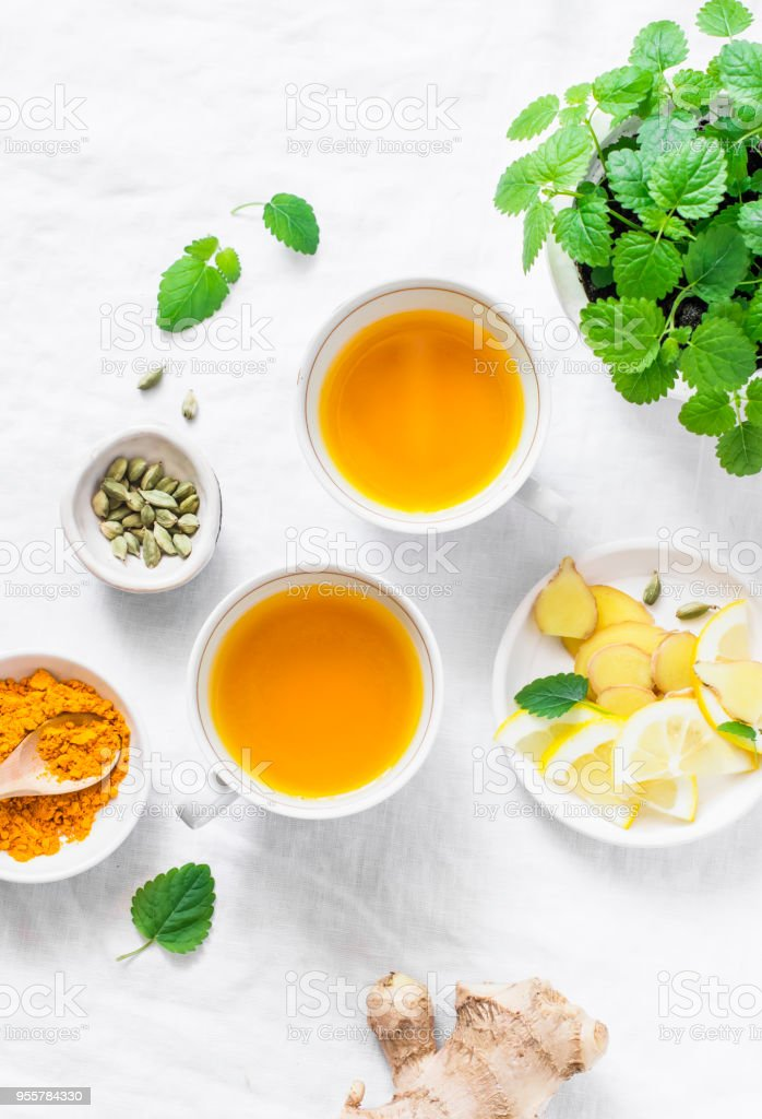 Turmeric, ginger anti-inflammatory green tea.  Healthy detox drink on light background, top view stock photo