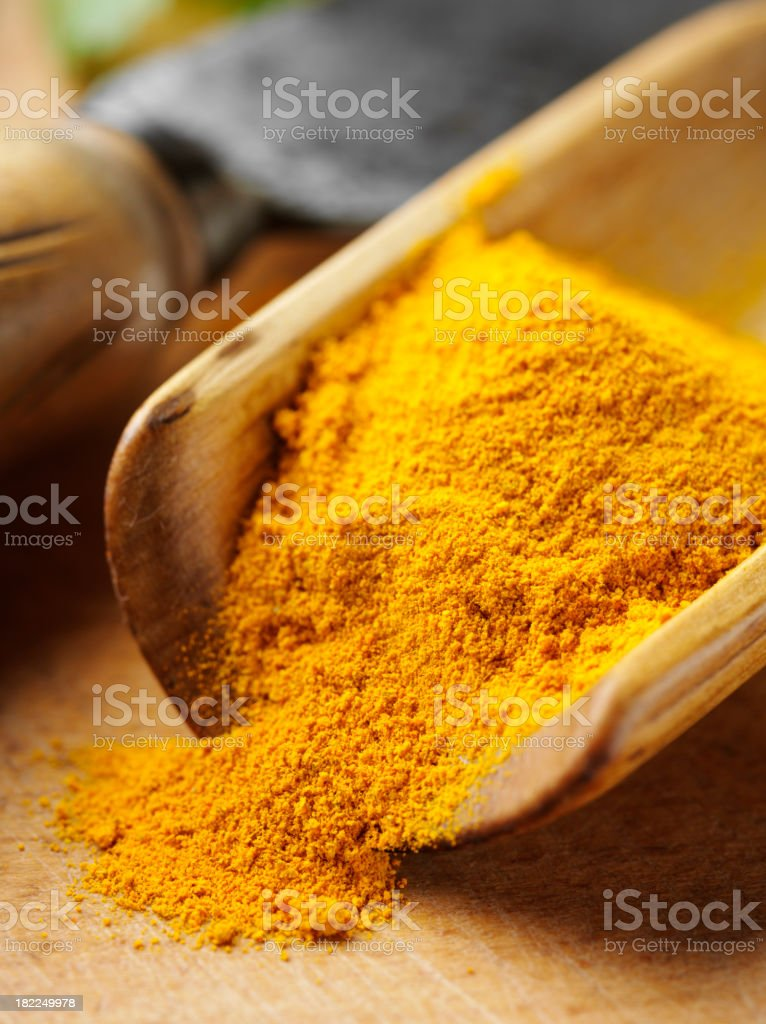 Turmeric in a Wooden Scoop royalty-free stock photo