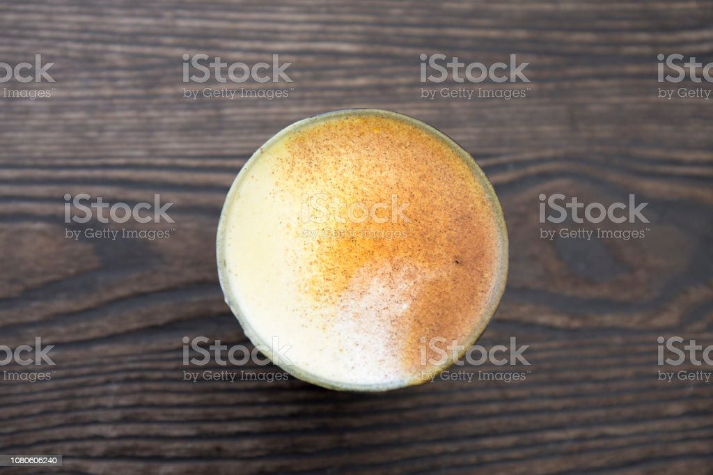 Turmeric latte in the cup stock photo