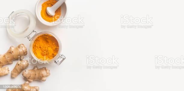 Turmeric Or Curcumin Curcuma Longa Linn Powder In Glass Stock Photo - Download Image Now