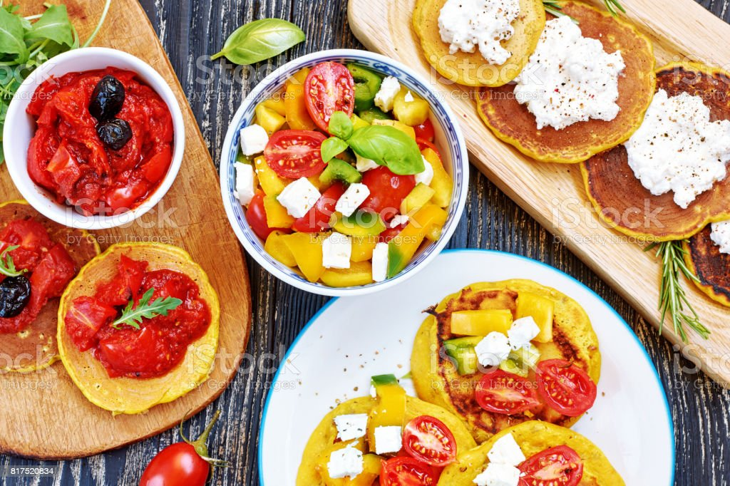Turmeric pancakes with assorted fillings. stock photo