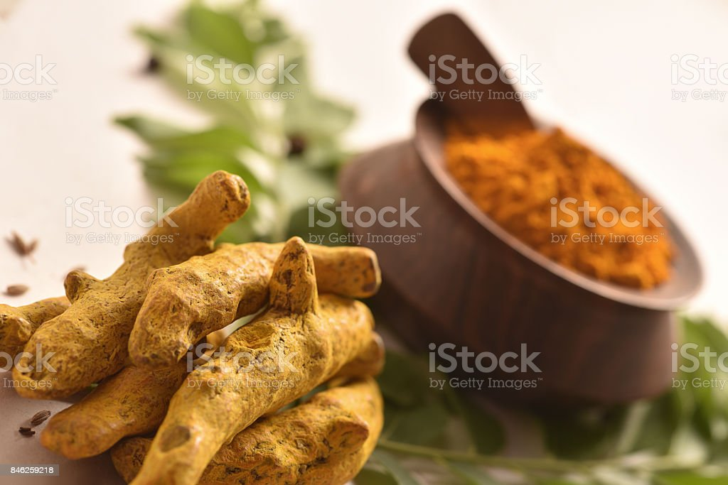 Turmeric Turmeric Whole and Powder curry leaves and cumin etc. on a white background Asian Food Stock Photo