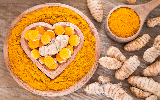 Turmeric Powder And Fresh Turmeric Curcuma Longa Stock Photo - Download  Image Now - iStock
