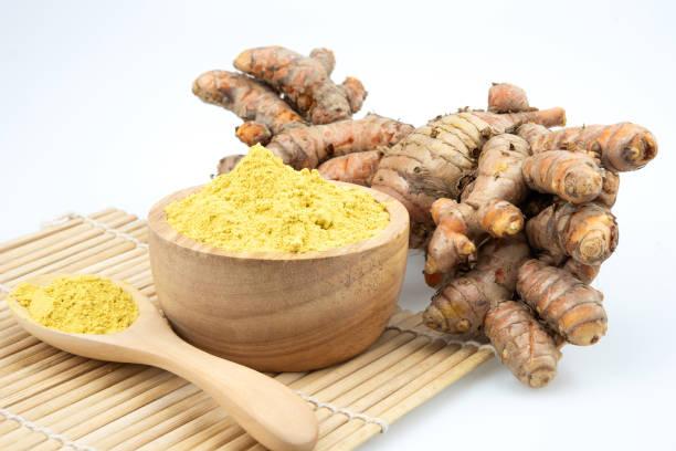 Turmeric powder and fresh turmeric stock photo