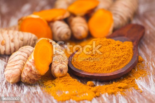 turmeric powder and roots, Asian origin plant containing curcumin has very powerful anti-inflammatory and antioxidant properties