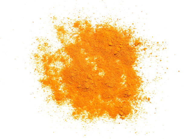 Turmeric (Curcuma) powder over white stock photo