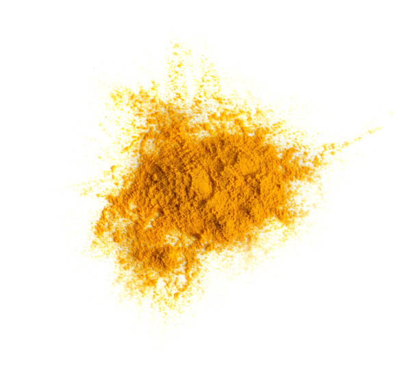 Turmeric (Curcuma) powder pile isolated on white background, top view. stock photo