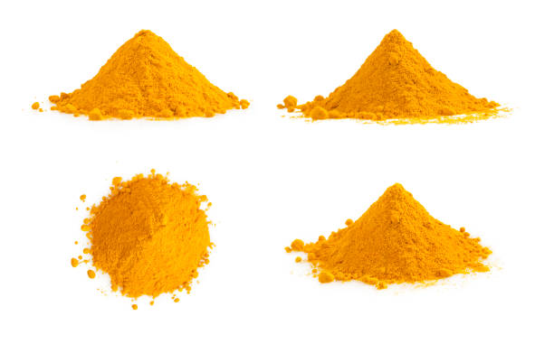 Turmeric powder pile isolated on white. Curcuma spice. Turmeric powder pile isolated on white. Curcuma spice. curry powder stock pictures, royalty-free photos & images
