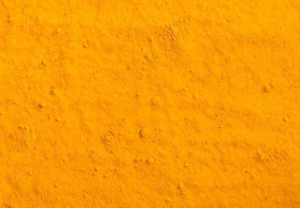 Turmeric powder texture. Yellow curcuma spice background. Turmeric powder texture. Yellow curcuma spice background. curry powder stock pictures, royalty-free photos & images