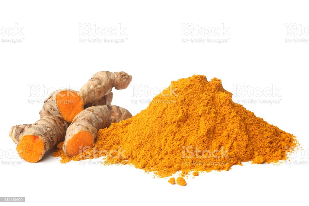 Turmeric rhizome and powder stock photo