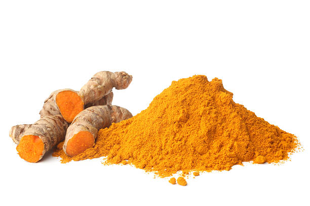 Turmeric rhizome and powder stock photo
