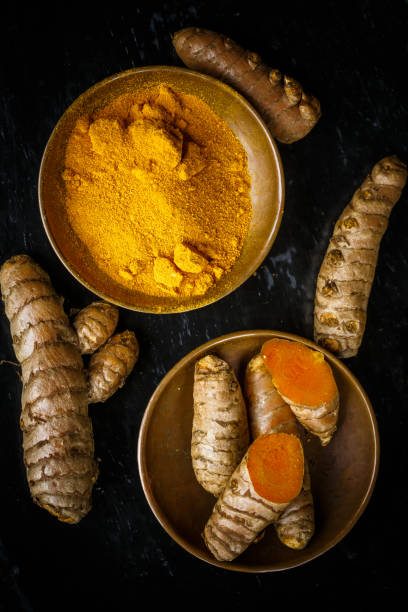 turmeric root and powder stock photo