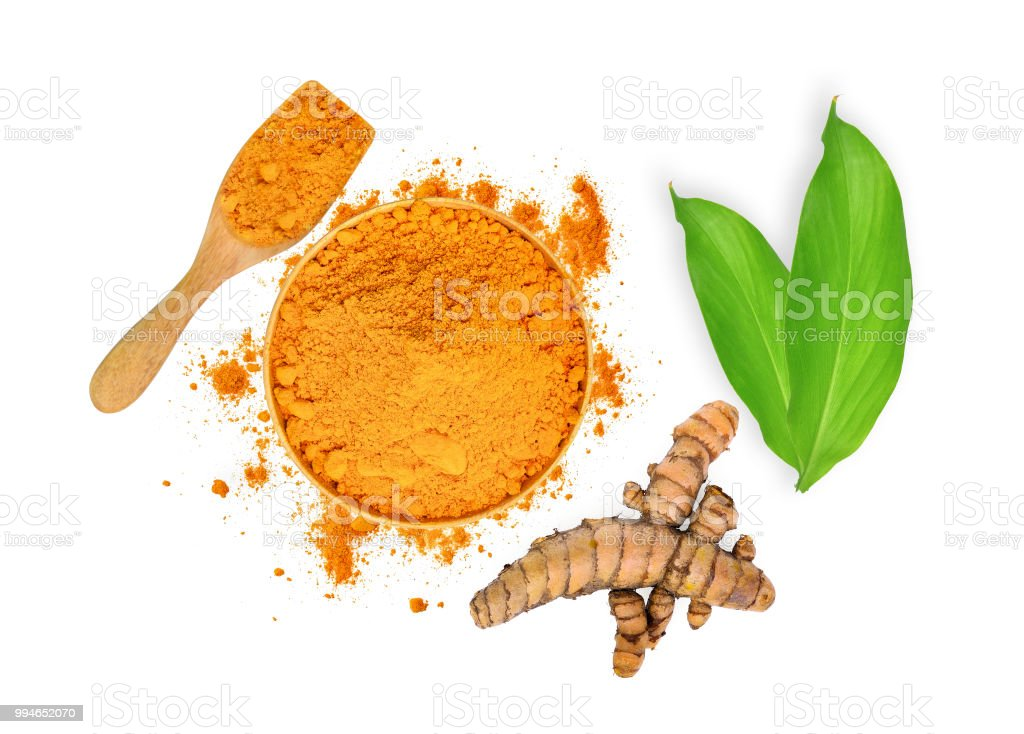 turmeric root and turmeric powder in wooden bowl and spoon with green leaves isolated on white background,flat lay,top view - fotografia de stock