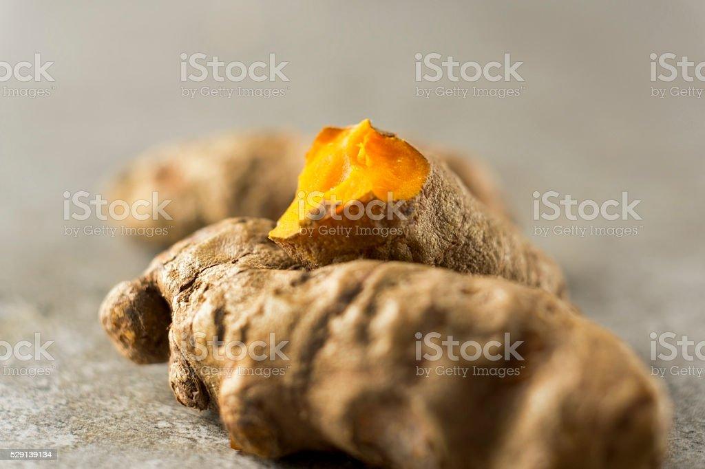 Turmeric root macro stock photo