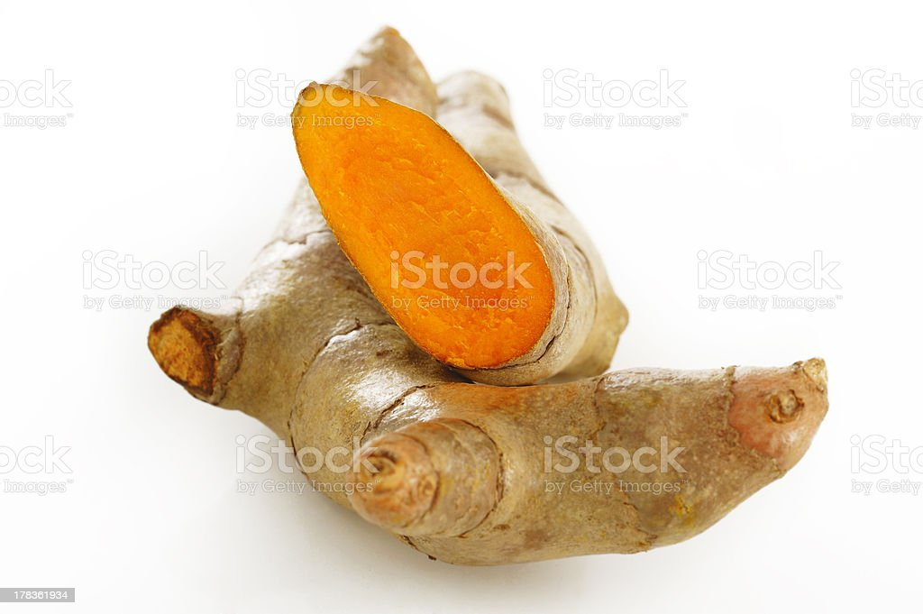 Turmeric root on white background royalty-free stock photo