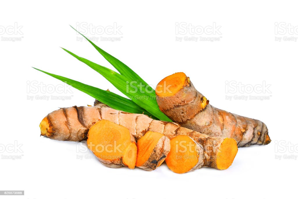 turmeric root with green leaves isolated on white background stock photo