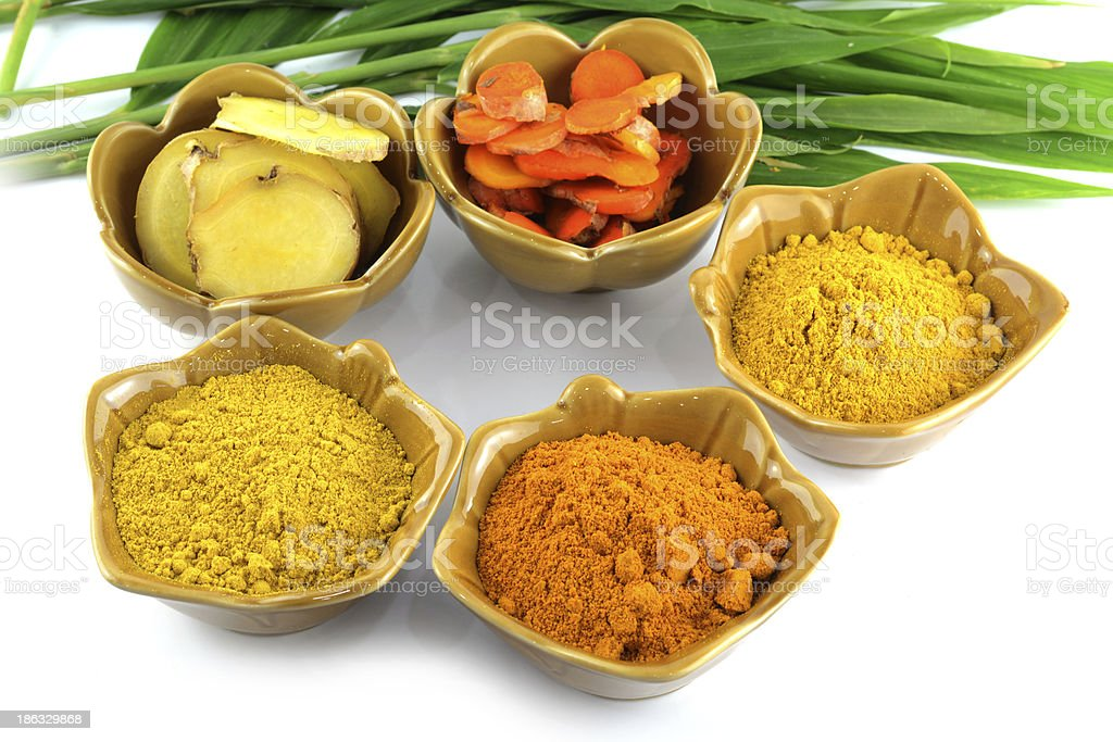 Turmeric roots and powder royalty-free stock photo