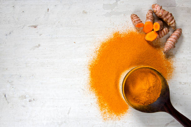 Turmeric Roots and Powder stock photo