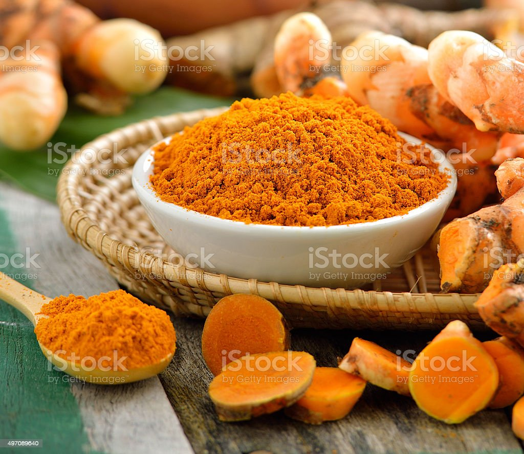 turmeric roots in the basket on wooden table stock photo