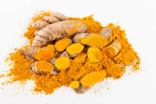 Turmeric roots isolated on white background stock photo