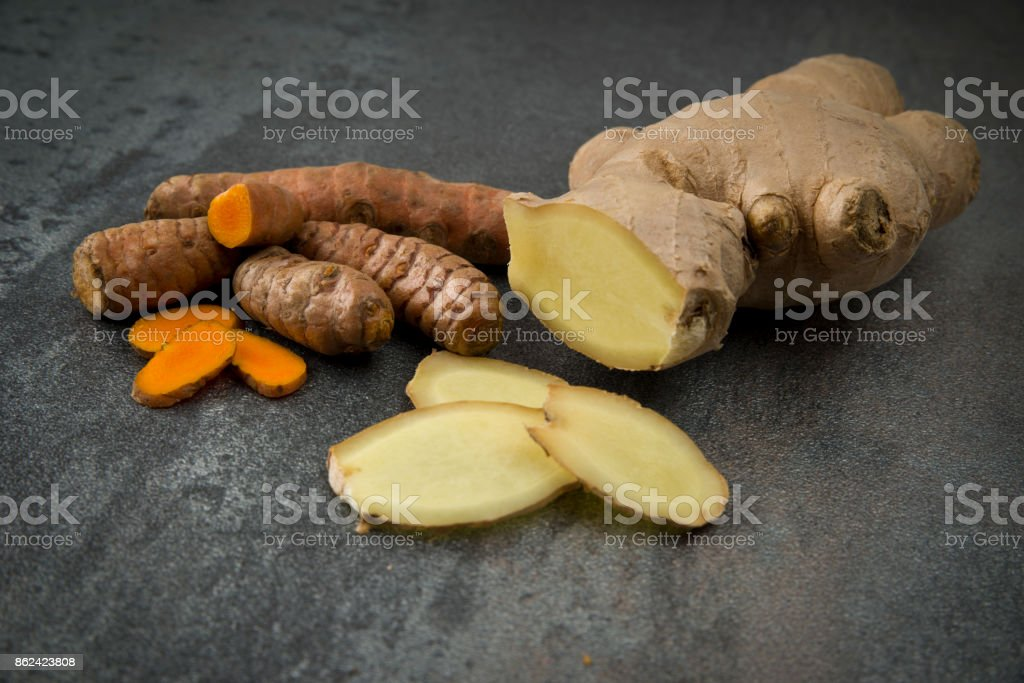 turmeric slices and ginger root sliced stock photo
