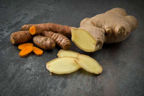 turmeric slices and ginger root sliced - ginger stock photos and pictures