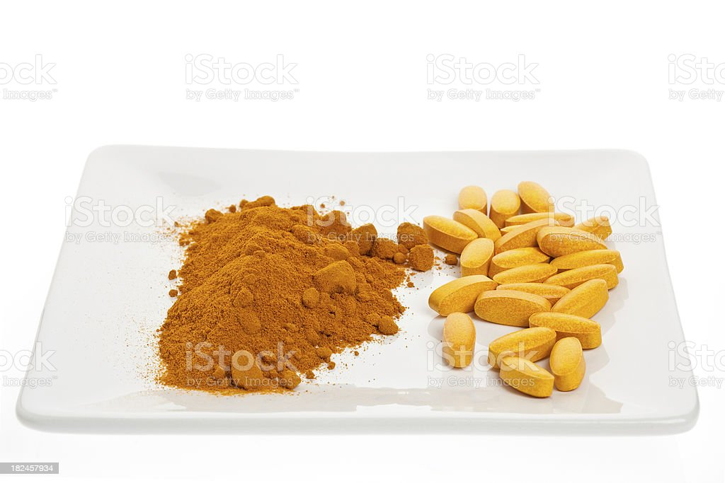 Turmeric Spice and Pills royalty-free stock photo