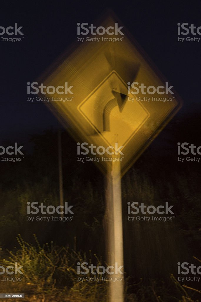 Turn ahead road sign double vision concept stock photo