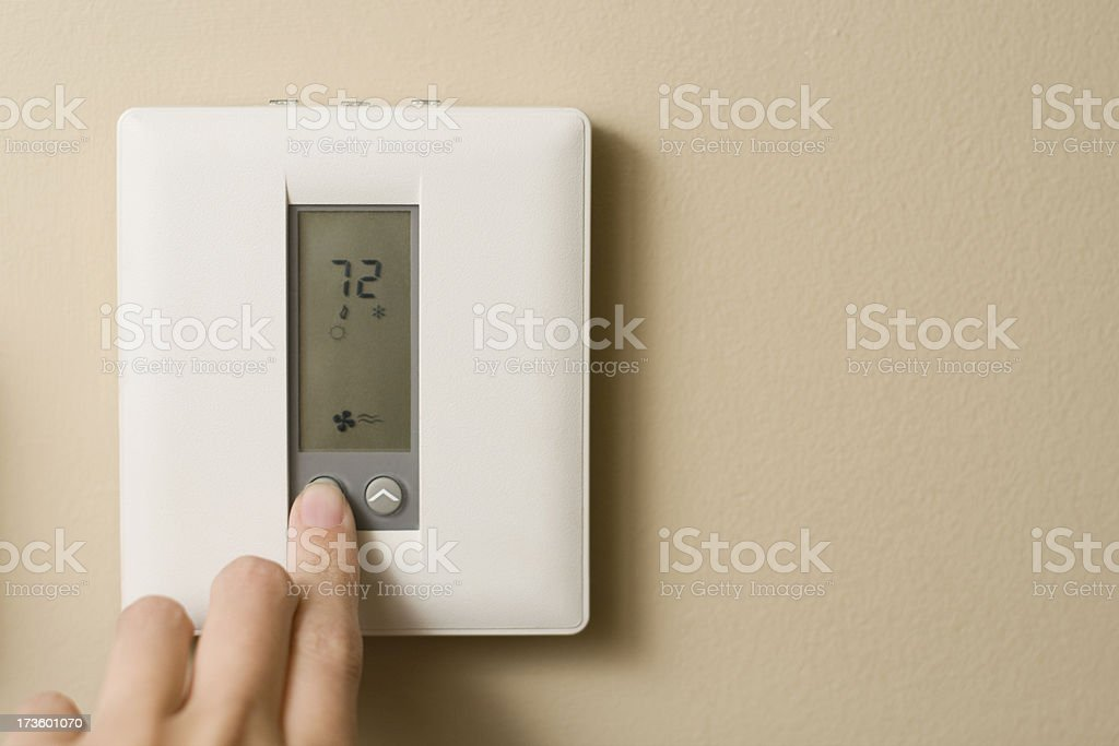 Turn down the Thermostat stock photo