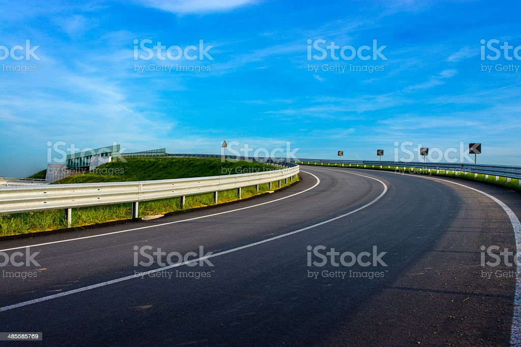 Turn in the road with guard rail stock photo