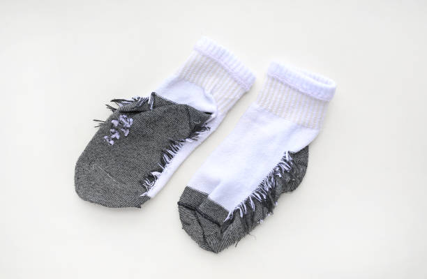 Turn inside out gray-white socks on white background. stock photo