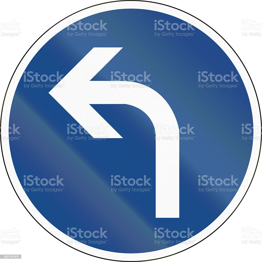 Turn Left Ahead stock photo